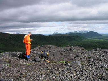earth scientist mapping in the field