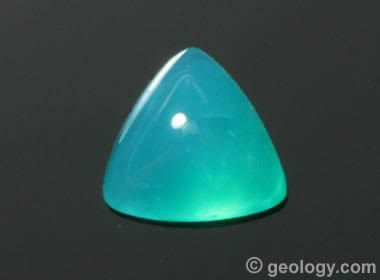 a vivid blue cabochon cut from gem silica