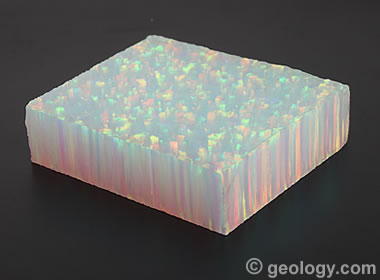 a block of synthetic opal showing the columnar growth pattern