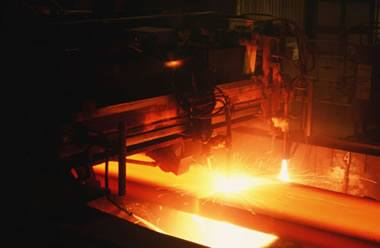 Steel Mill: Most iron ore is used to make steel. Here a steel slab is