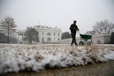 salting sidewalks at the White House